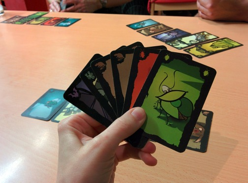 board-game-review-cockroach-poker-hand