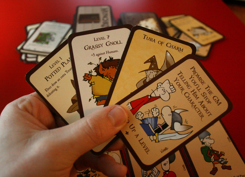 A hand of cards showing a grassy gnoll, a level up, and tuba of charm