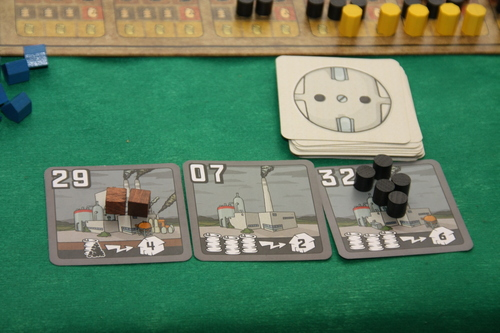 A couple of power plant cards showing the resources needed to power them.