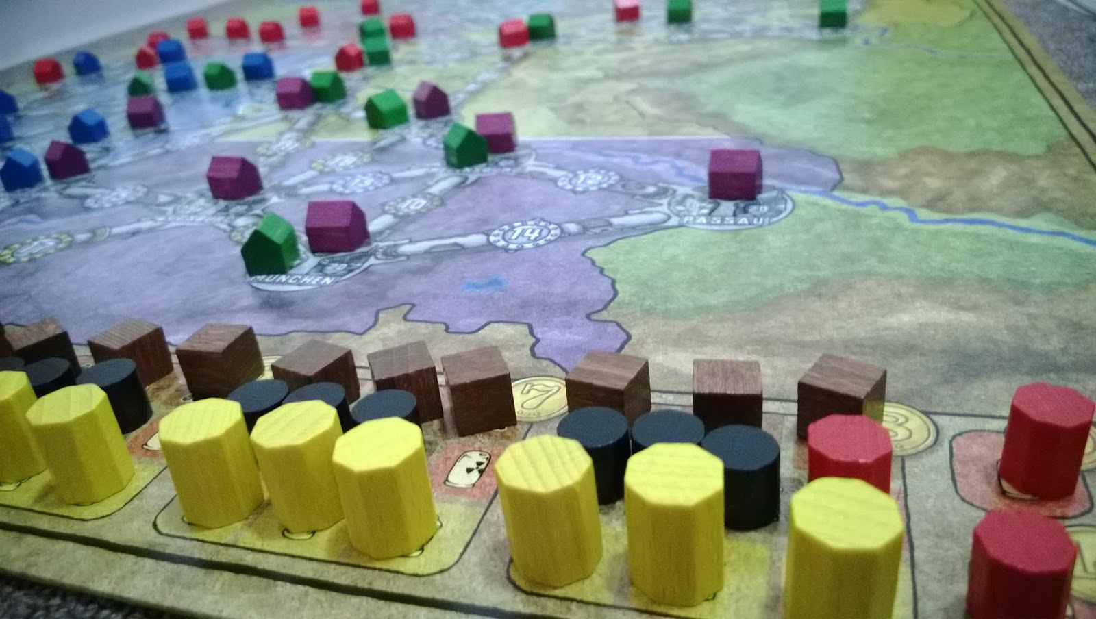 Power Grid mid game, wooden houses, resources line the board