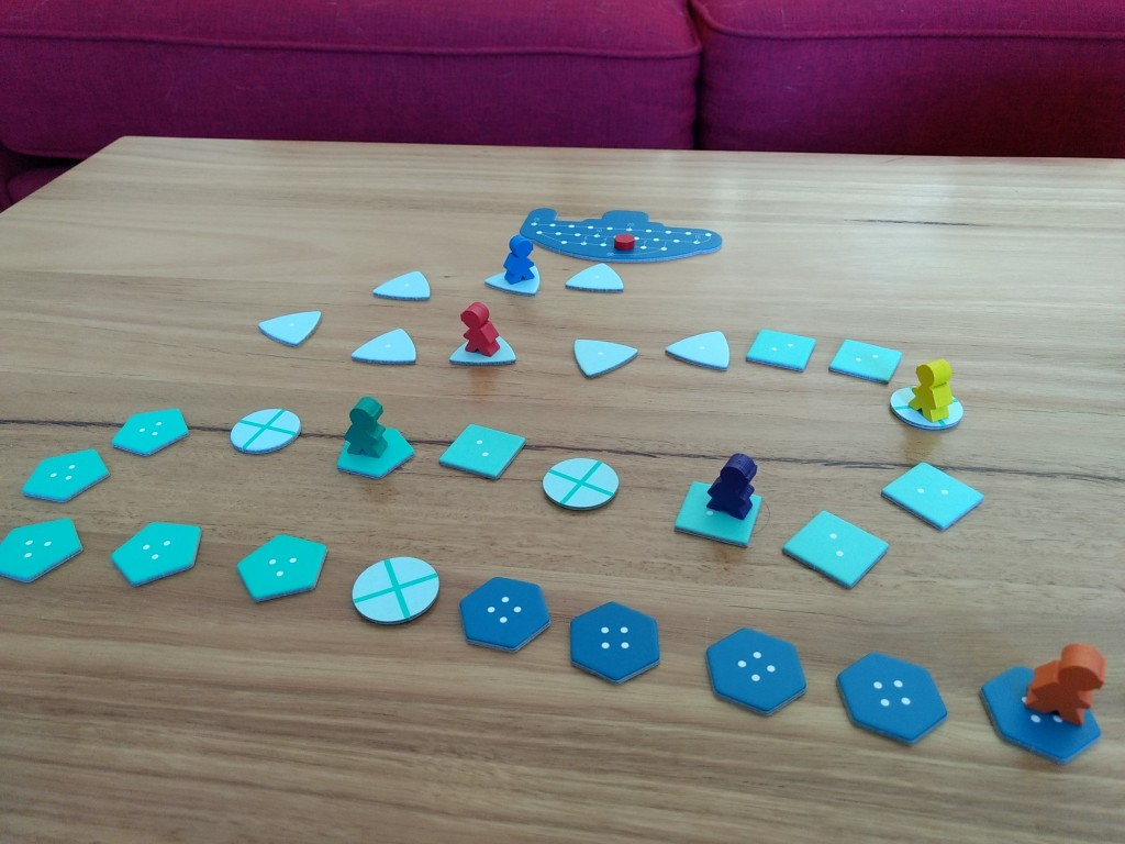 Deep Sea Adventure laid out on the table, meeples positioned at various points of the underwater track. Orange is at the depths.