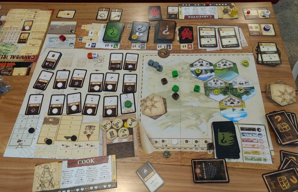 A game of Robinson Crusoe in play, inventory cards, dice, mystery tokens, player boards, treasure cards, exploration tiles you name it, it's there!