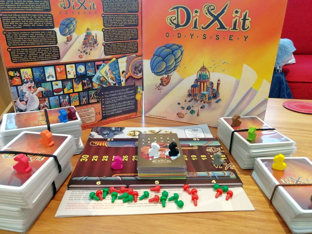 Dixit Odyssey components, plus some expansions. Lots of cards, bunny meeples, and pegs.