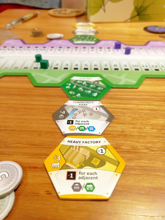 roll-to-review-board-game-suburbia-setup