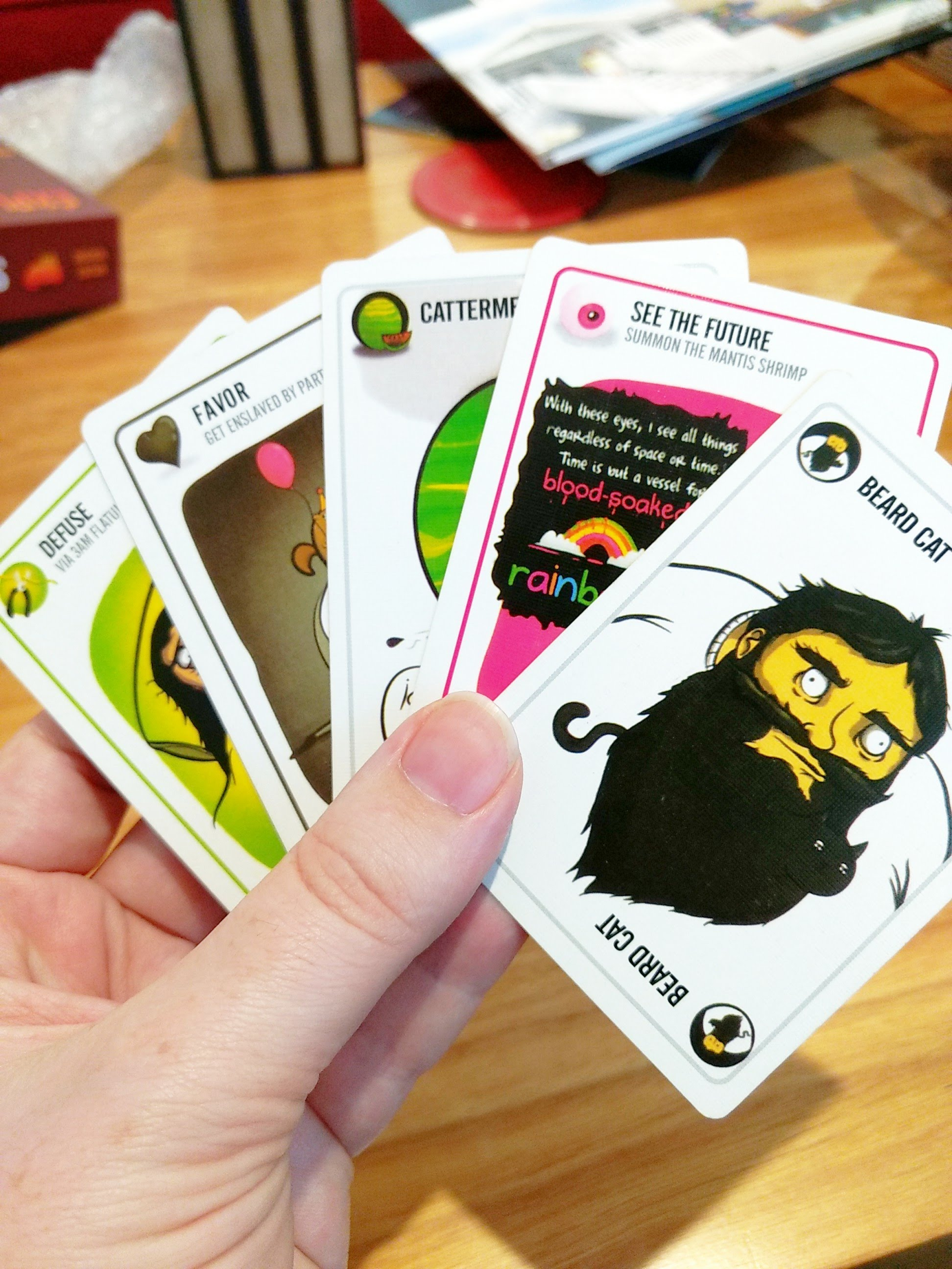 A hand of the cards in Exploding Kittens. Such as beard cat, cattermelon, and see the future!