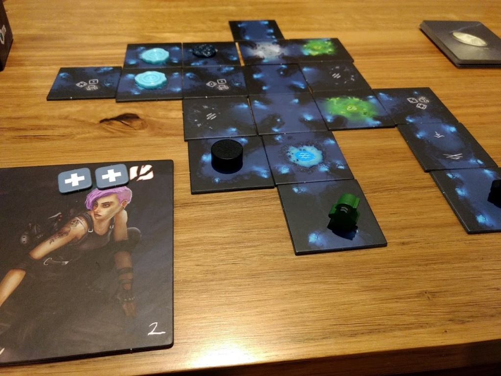 Sub Terra board mid way through the game, there's one horror very close to a green adventurer.