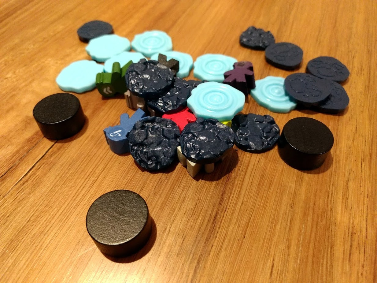 Tokens that come with Sub Terra, plastic water, and rock tokens, meeples for explorers, and fat flat wooden cyclinders for monsters.
