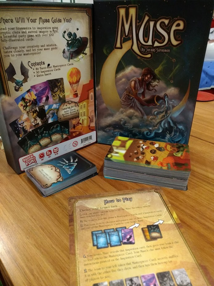 Muse game components, one standard deck of cards with pictures, a smaller deck of cards with what the player must do to convey the image.