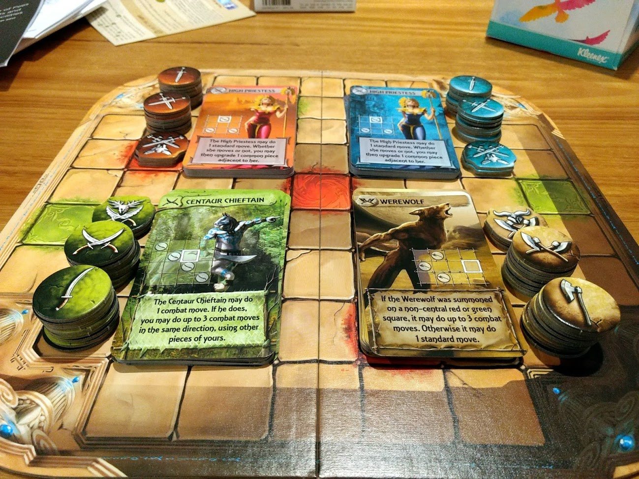 All components you get in Tash-Kalar, it shows the four factions red, blue, green, and brown.