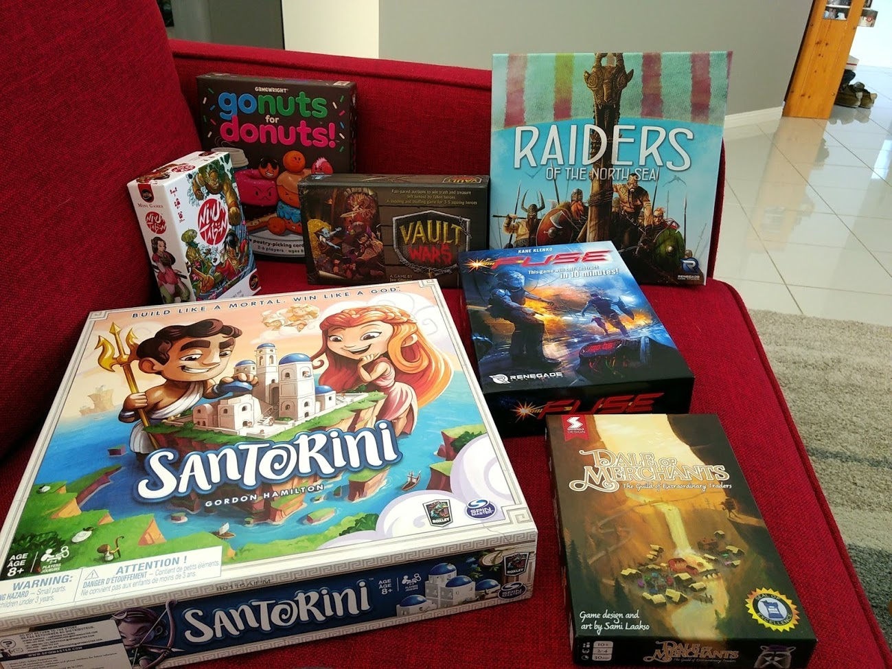 Board game haul includes: Dale of Merchants, Santorini, Fuse, Raiders of the North Sea, Vault Wars, Ninja Taisen, Go Nuts for Donuts.