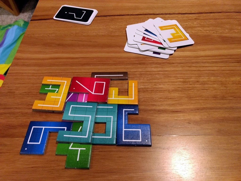 NMBR 9 game in progress, numbered polynomial tiles placed on top of one another.