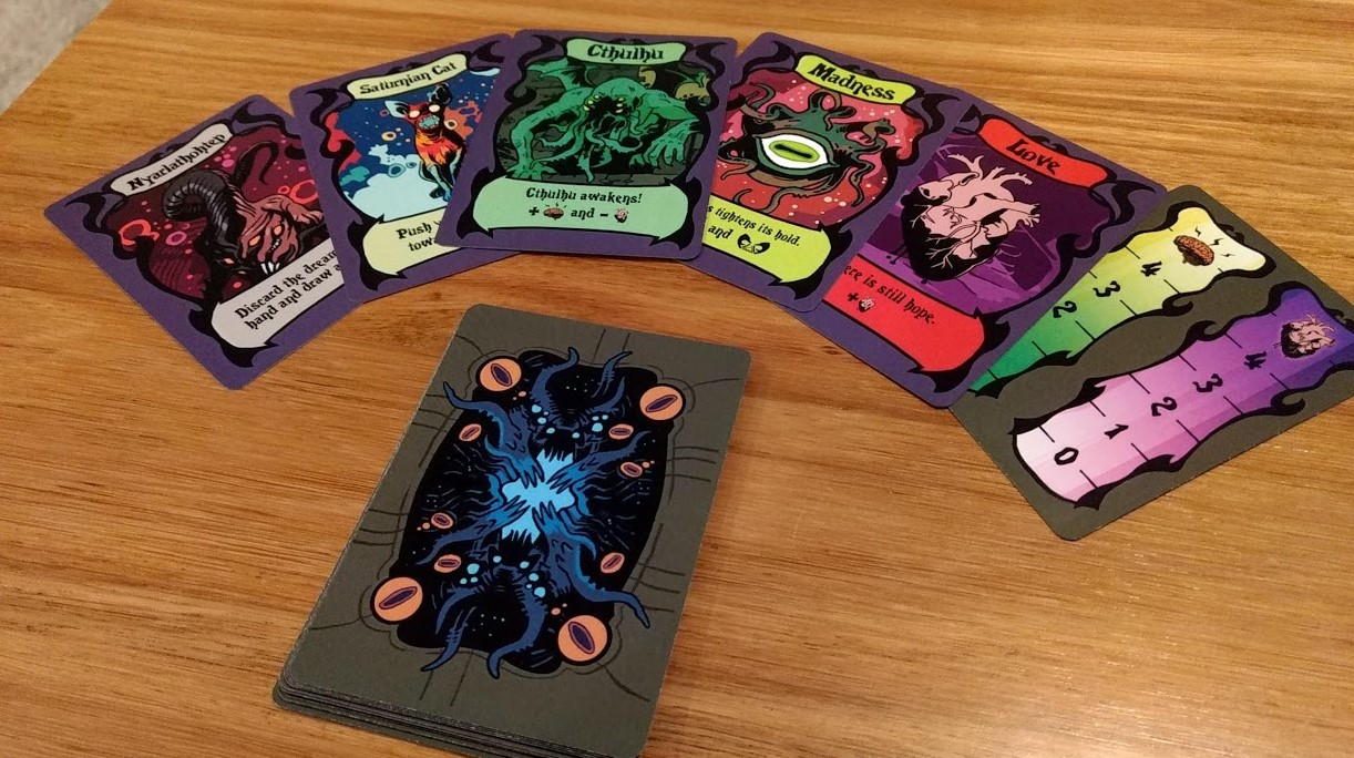 Showing some of the cards of Mad Love. Cthulhu, Madness, Love, Nyarlathohtep, Saturnian Cat.