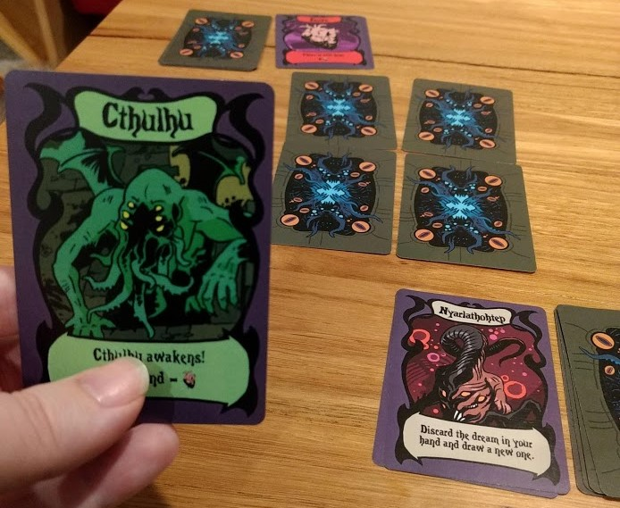 Middle of a game of Mad Love, have Cthulhu card in my hand.