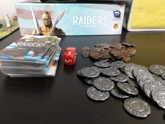 Metal coins, cardboard provision tokens, two red dice, a deck of crew cards.