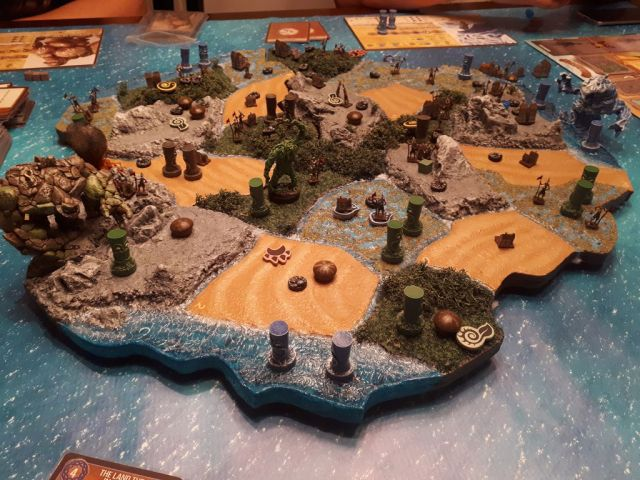 Spirit Island map with custom miniatures, and tokens.