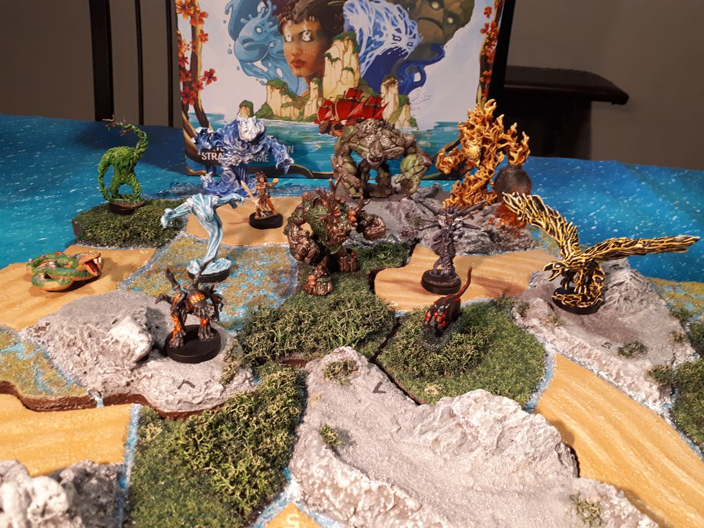 Custom miniatures of all Spirit Island heroes lined up.