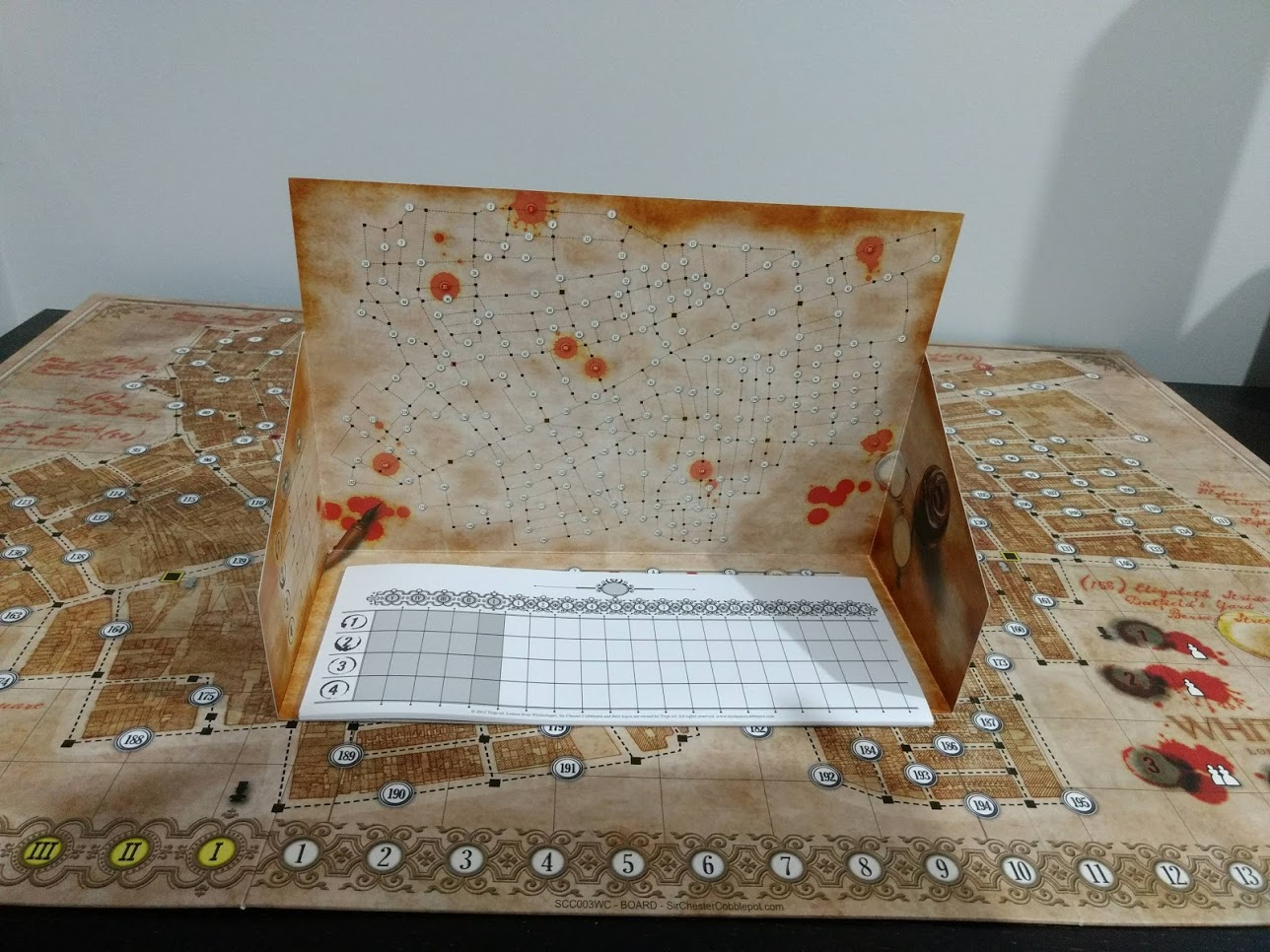 Letters From Whitechapel game board, with the compartment hiding Jack's movement set up.