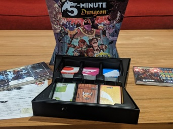 The components and insert of 5 Minute Dungeon