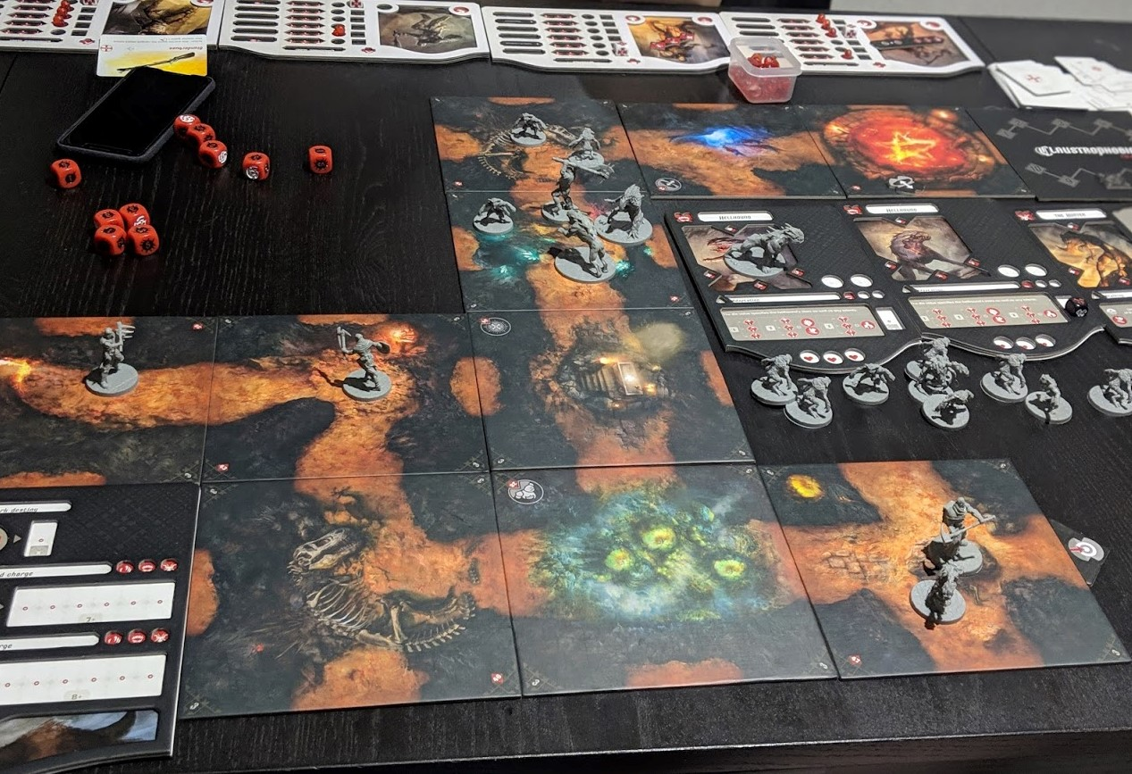 A dungeon all set up and showing the size of the game. It almost doesn't fit on the table.