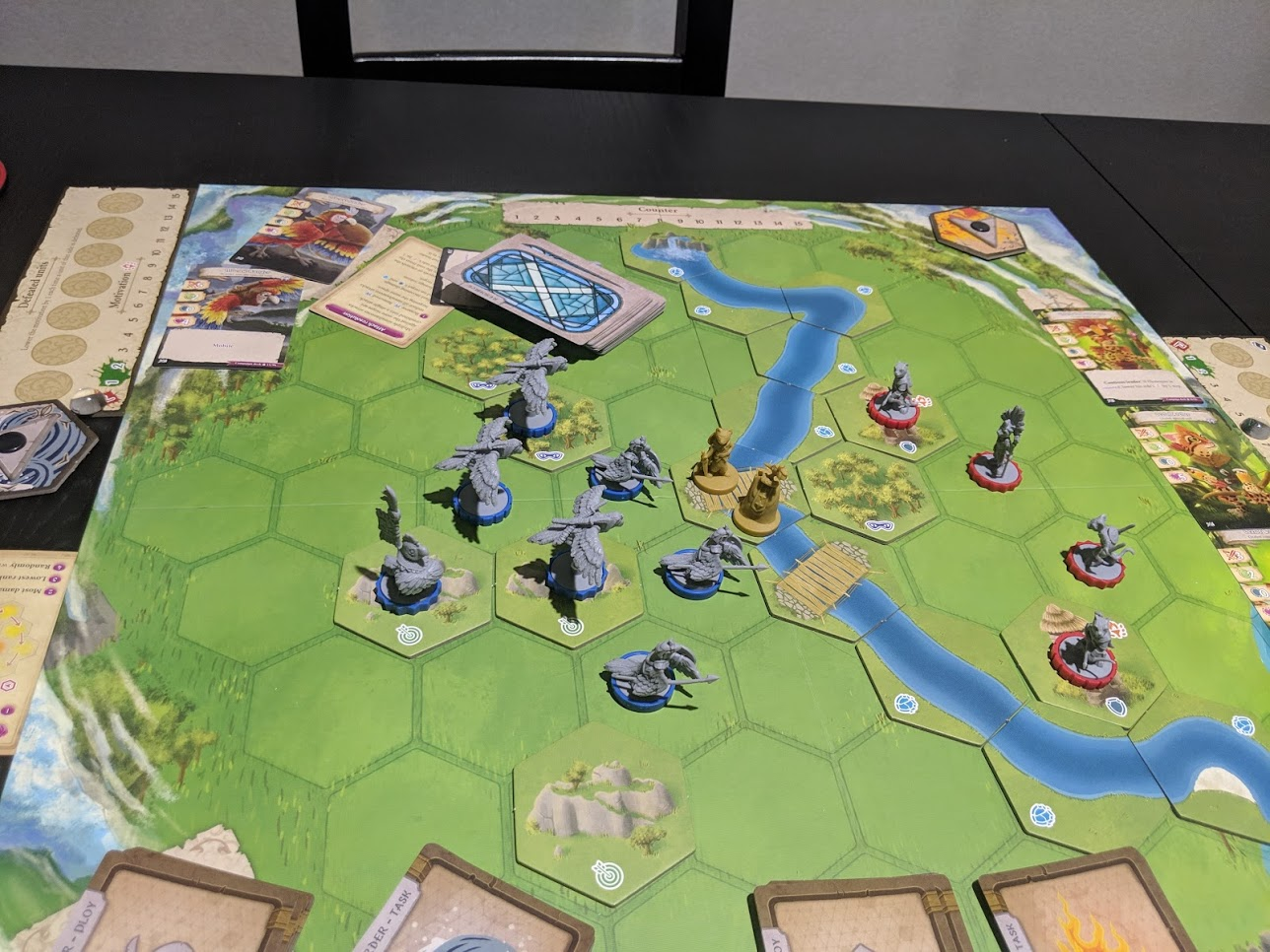 Dawn of the Peacemakers board set up, with the Macaw army to the left, Ocelot army to the right, with a river and two bridges separating them.