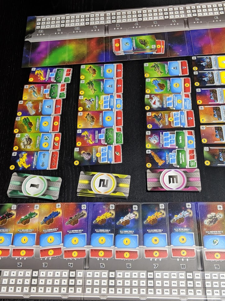 The Space Base market place. Four rows of six cards each. Each row more powerful than the last.