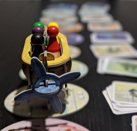 Boat from Celestia, all meeples aboard.