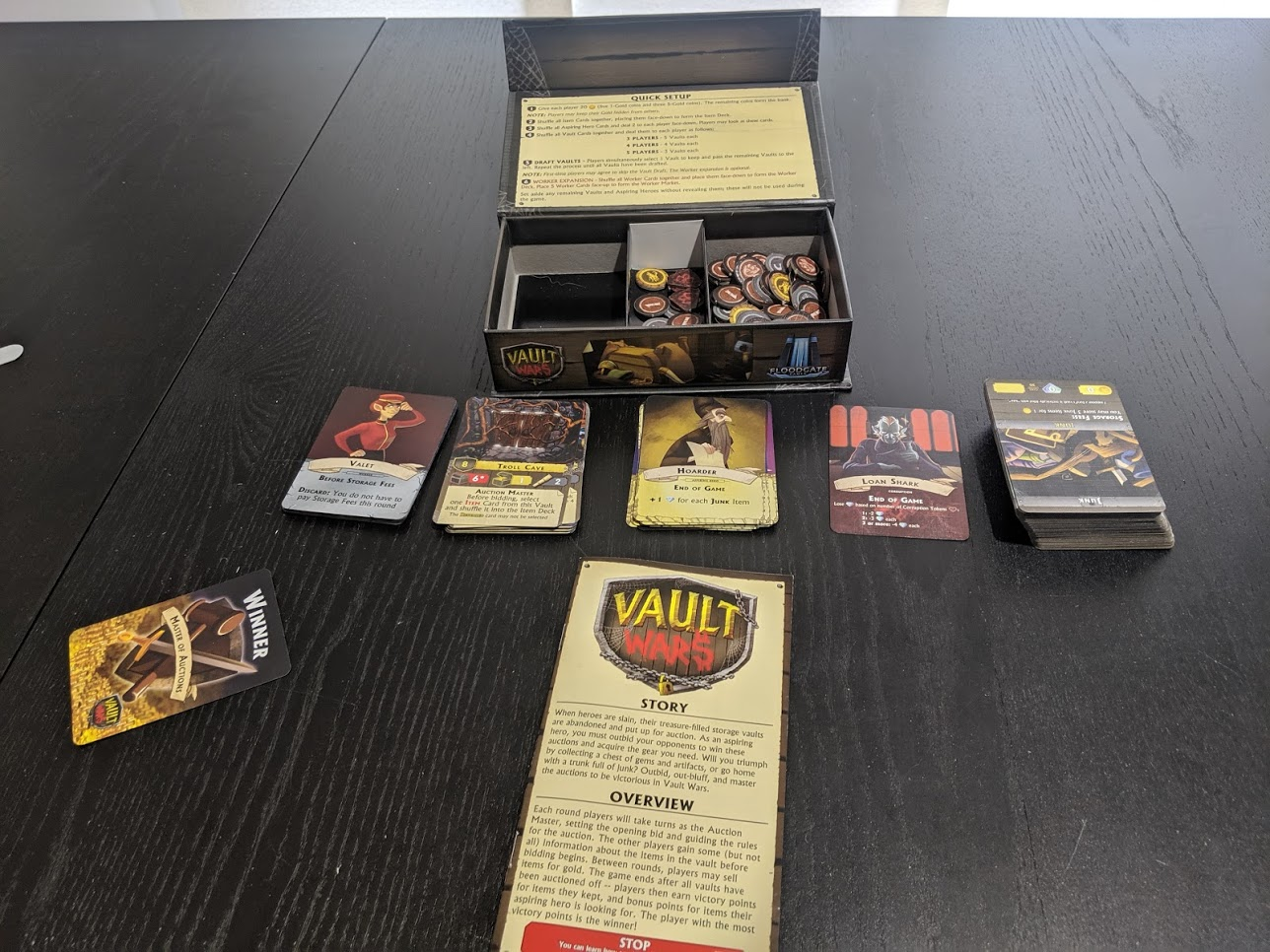 Displaying all of the components in Vault Wars as well as the box it comes in.
