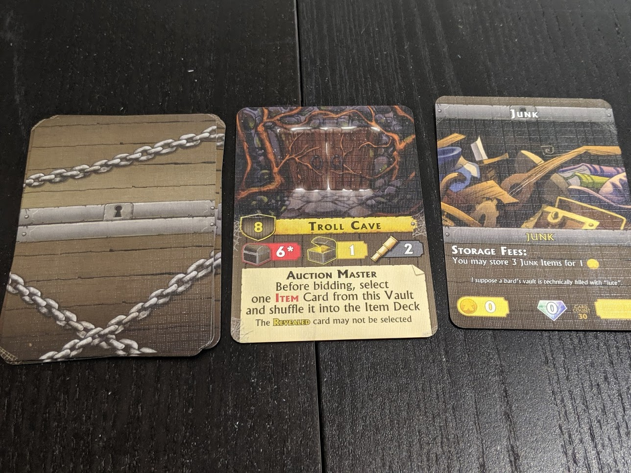 What a vault in play looks like. A pile of cards, next to a vault card, next to a face up Junk card.