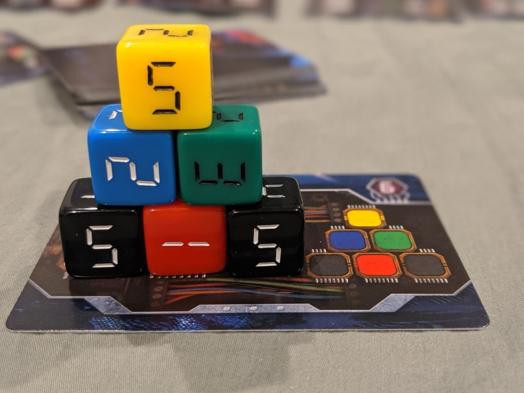 An example of a bomb card in Fuse. A pyramid of dice matching the card.