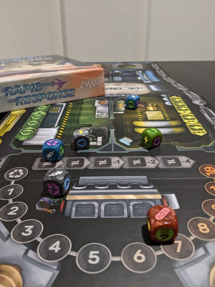 Pandemic Rapid Response board laid out, with some of the dice displayed in the foreground.