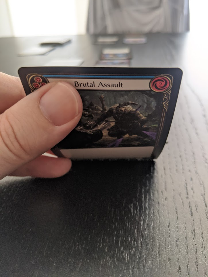 Flesh and Blood In play, I've got a Brutal Assault card ready to activate.