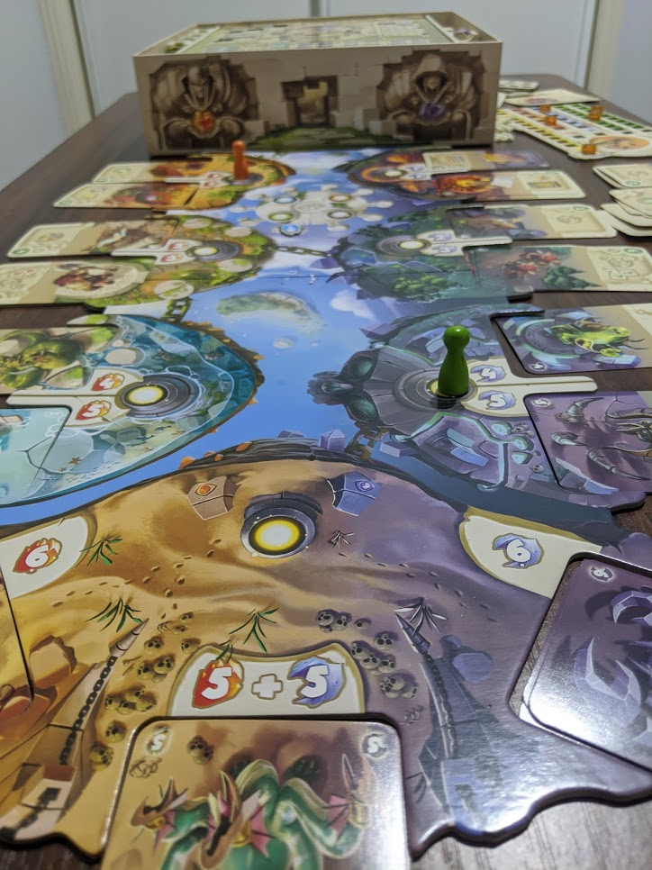 The Dice Forge board laid out with green & orange player markers on placement spots.