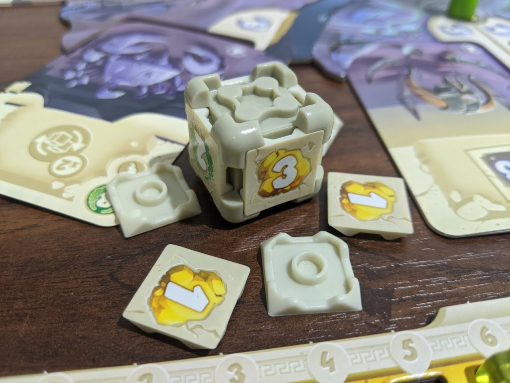 A Dice Forge die with its sides pulled off.