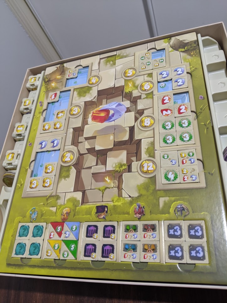 The Dice Forge tile container, makes for storing the game a breeze.