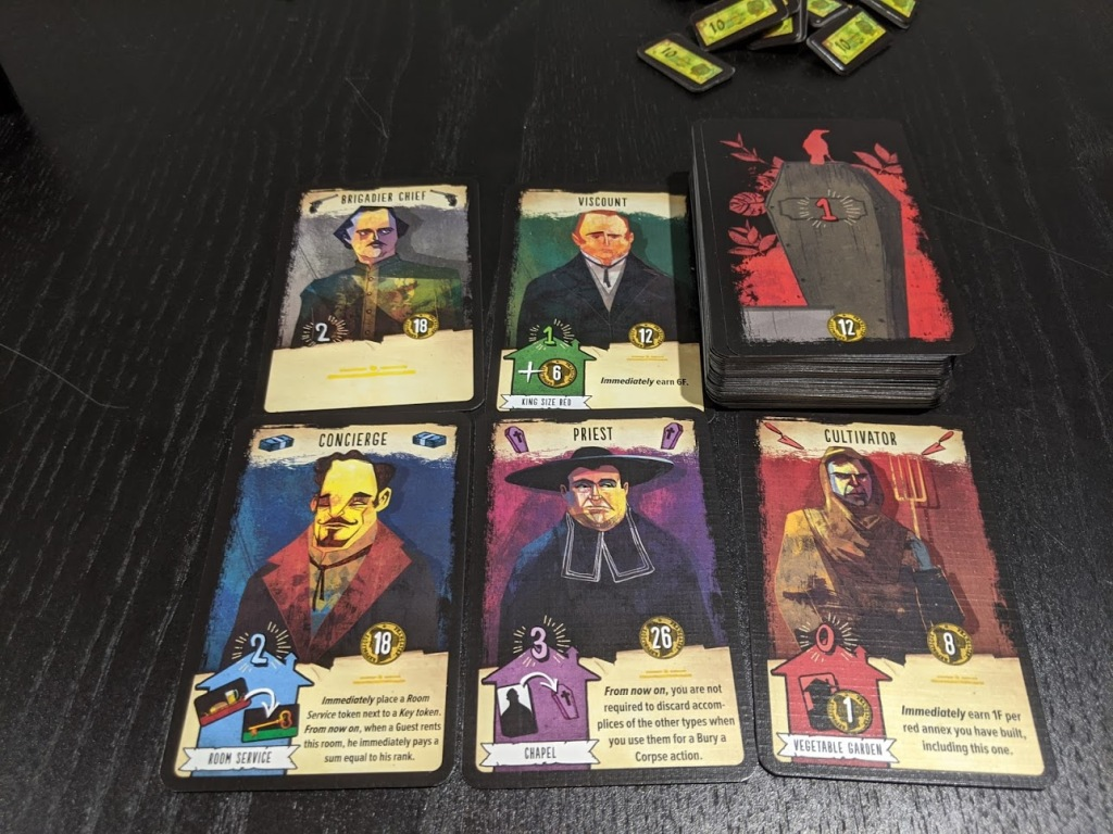 Some of the cards from The Bloody Inn, the art is angular, and the shades colours are macabre.