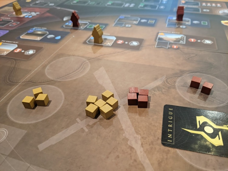 The conflict, gold has 6 cubes, red has 4, but has a hidden intrigue card as well.