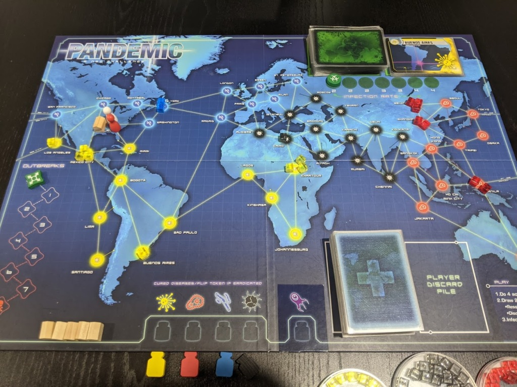 Pandemic game board showing an atlas of the world.