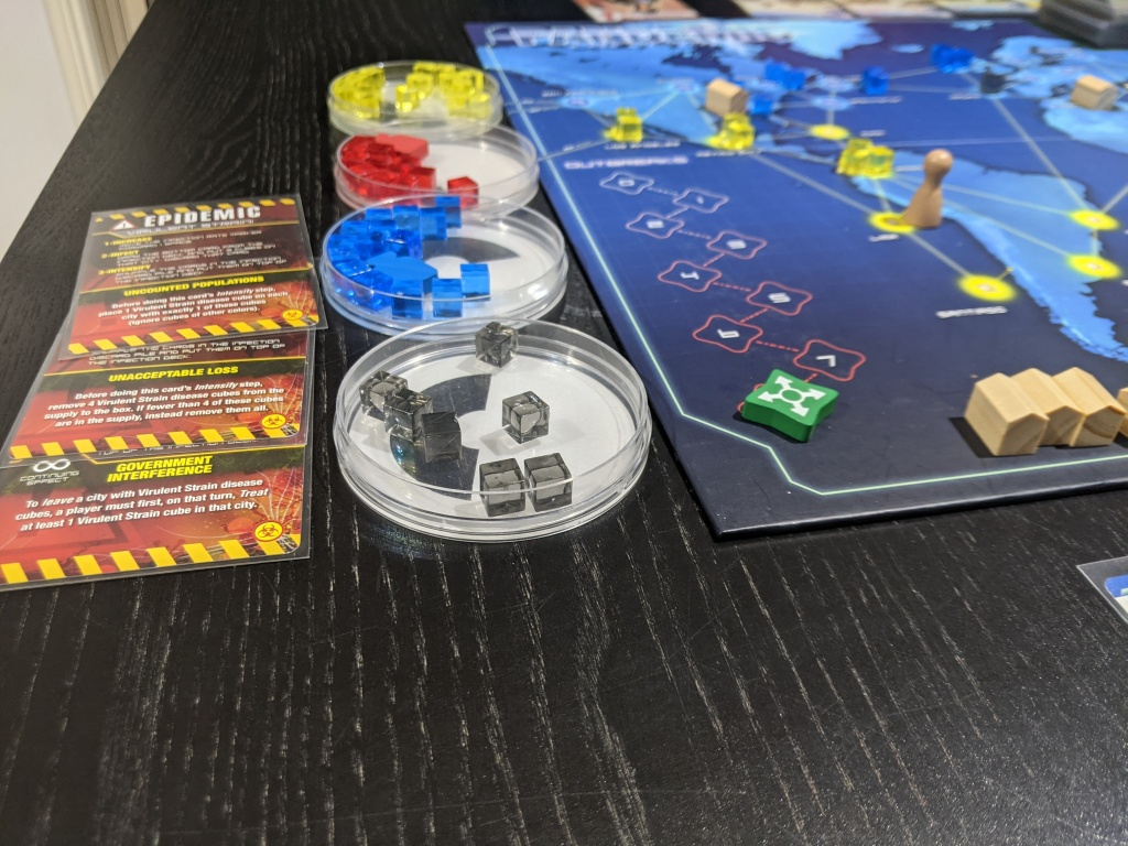 Three of the Virulent Strain cards that come with Pandemic: On the Brink. On the right it shows that we lost due to outbreaks.