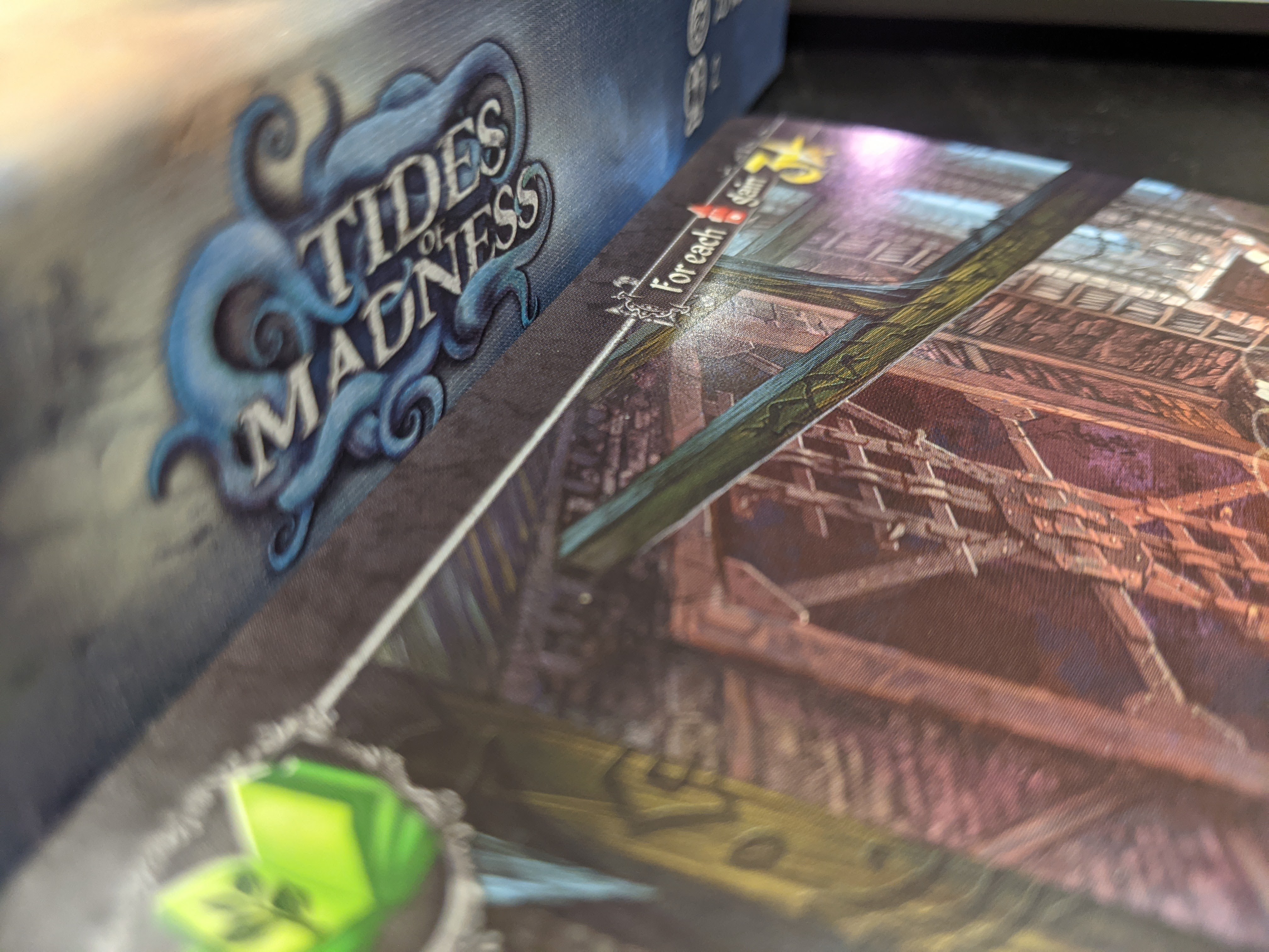 Up closes of the Tides of Madness box, showing card art.