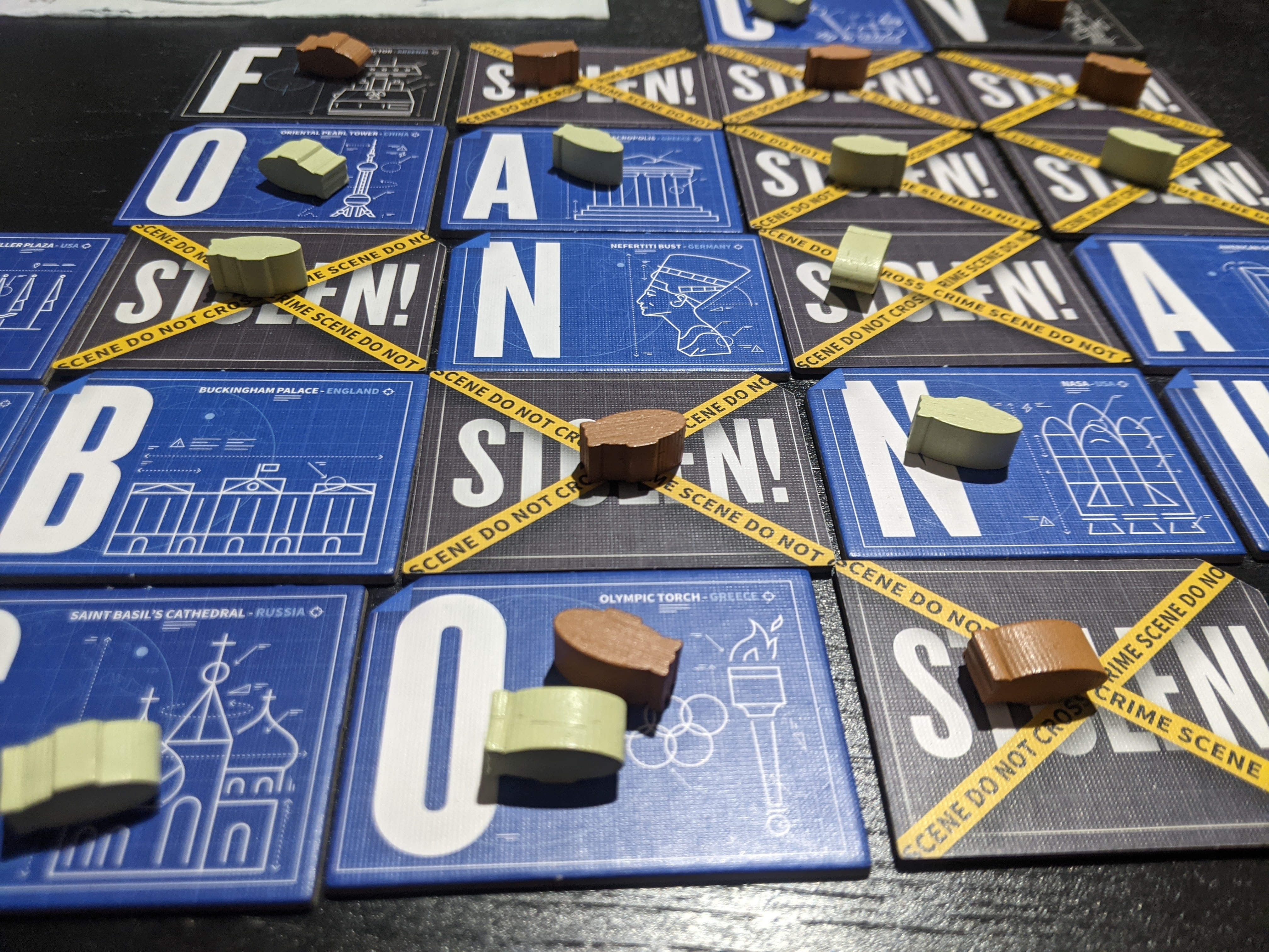 Word Domination mid game; several tiles are flipped to their stolen side. Zeppelin tokens of both colours litter the board.