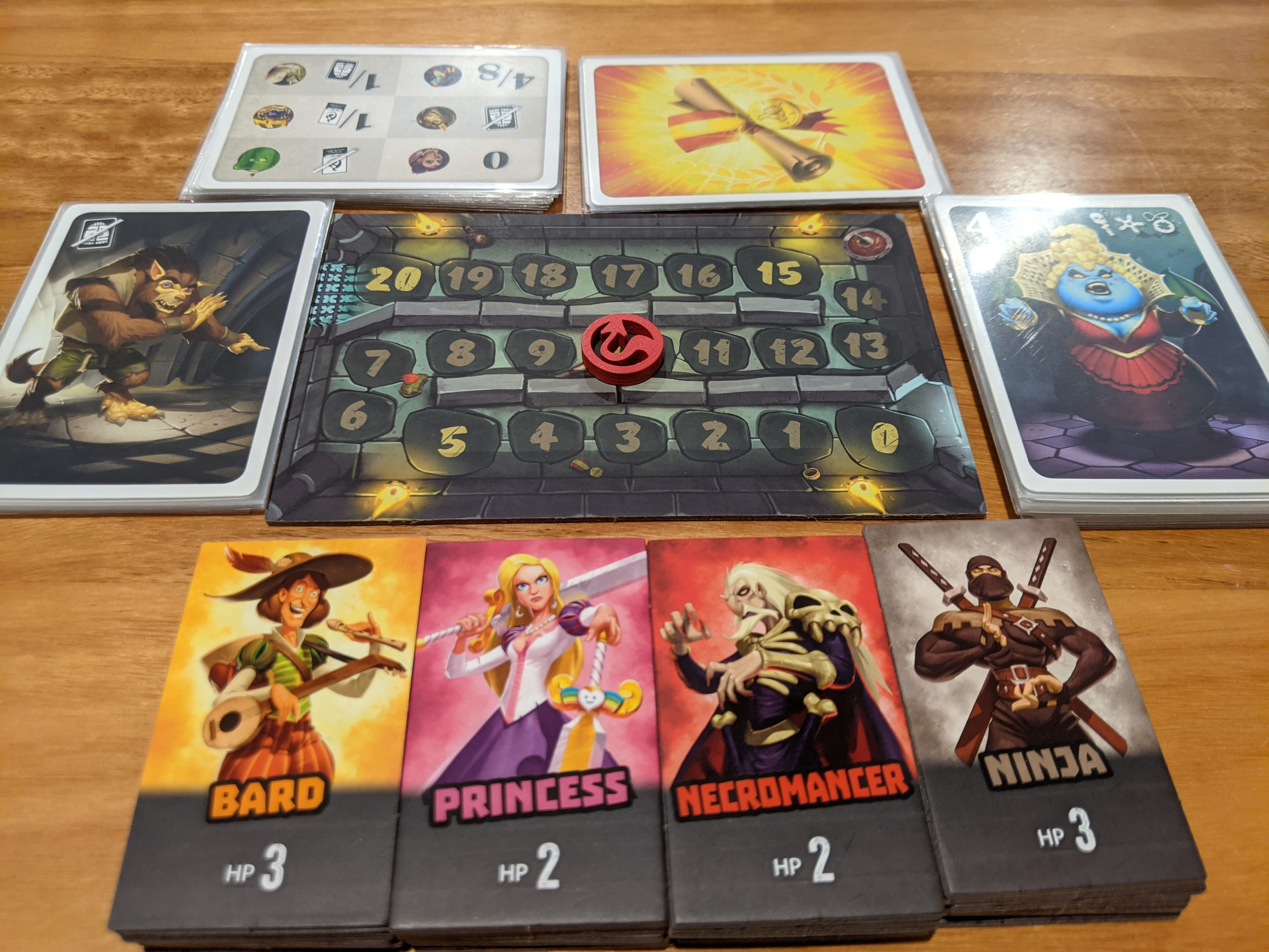 The components for Welcome Back to the Dungeon. Special creatures on the left, old monsters of the right, the four adventures below, and health tracker in the middle.