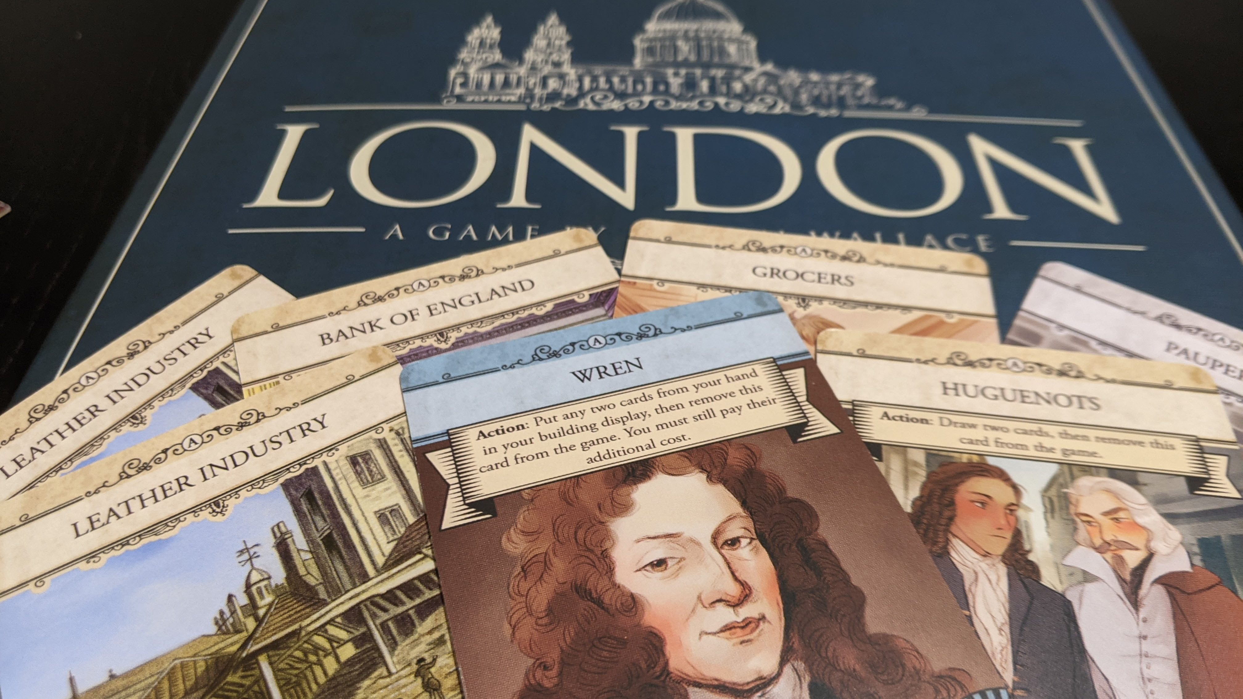 Showing some of the card art from London in front of  the box.